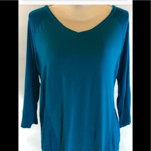 Two 3/4 length sleeved shirts